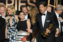 Steven Levitan (r) and the cast and producers of Modern Family accept an award at the 66th Emmy Awards.