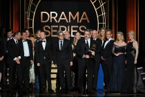 Vince Gilligan (c) and the cast and producers of Breaking Bad accept an award at the 66th Emmy Awards.