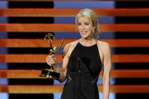 Breaking Bad writer Moira Walley-Beckett accepts an award at the 66th Emmy Awards.