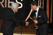 Jay Leno (l) presents Steven Levitan (r) of Modern Family an award at the 66th Emmys.