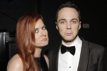 Debra Messing and Jim Parsons at the 66th Emmys.