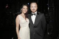 Lucy Liu (l) of Elementary and Aaron Paul (r) of Breaking Bad backstage at the 66th Emmys.