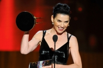 Julianna Margulies of The Good Wife accepts an award at the 66th Emmy Awards.