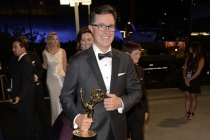 Stephen Colbert of The Colbert Report celebrates his win at the 66th Emmys Governors Ball.