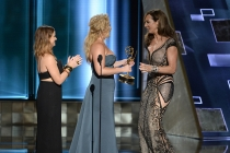 Amy Poehler and Amy Schumer present Allison Janney an award at the 67th Emmy Awards.