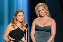 Amy Poehler and Amy Schumer present at the 67th Emmy Awards.