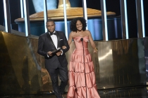 Anthony Anderson and Tracee Ellis Ross present an award at the 67th Emmy Awards.