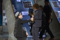Bradley Whitford presents Jill Soloway an award at the 67th Emmy Awards.