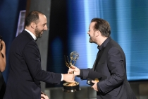 Tony Hale accepts an award from Ricky Gervais at the 67th Emmy Awards.