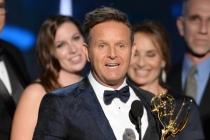 Mark Burnett accepts his award at the 67th Emmy Awards.