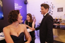 Maggie Gyllenhaal and Rob Lowe backstage at the 67th Emmy Awards.