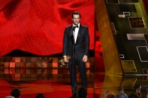 Jon Hamm accepts an award at the 67th Emmy Awards.