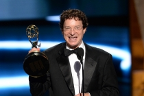 Chuck O'Neil accepts his award at the 67th Emmy Awards.