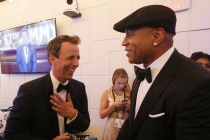 Seth Meyers and LL Cool J backstage at the 67th Emmy Awards.