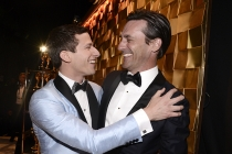 Andy Samberg and Jon Hamm embrace backstage at the 67th Primetime Emmy Awards.