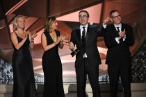 John Oliver and the crew of Last Week Tonight with John Oliver accept an award at the 2016 Primetime Emmy.