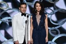Rami Malek and Abigail Spencer on stage at the 2016 Primetime Emmys.