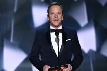Kiefer Sutherland presents an award at the 2016 Primetime Emmys.