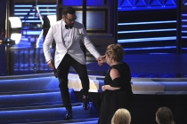 Jeremy Piven escorts Ann Dowd on stage to accept her award at the 2017 Primetime Emmys.