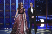 Debra Messing and Chris Hardwick present an award at the 2017 Primetime Emmys.