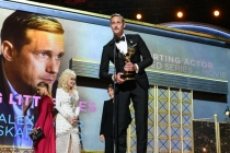 Alexander Skarsgard accepts an award at the 69th Emmy Awards.