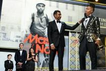 Aziz Ansari and Lena Waithe accept their award on stage at the 69th Primetime Emmys