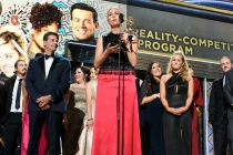 The team from The Voice accepts an award at the 69th Emmy Awards.