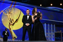 Seth MacFarlane and Emmy Rossum present an award at the 69th Emmy Awards.