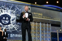 Charlie Brooker accepts his award at the 69th Emmy Awards.
