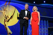 Alec Baldwin and Edie Falco on stage at the 69th Emmy Awards.