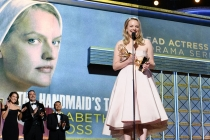 Elizabeth Moss accepts her award at the 69th Primetime Emmys