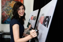 "Jessica Paré signs the poster at ""A Farewell to Mad Men,"" May 17, 2015 at the Montalbán Theater in Hollywood, California."