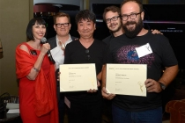 Television Academy governors Lynda Kahn and Eric Anderson present certificates to the Silicon Valley team at the Motion and Title Design Nominee Reception in West Hollywood, California.