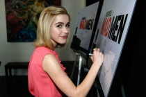 "Kiernan Shipka signs the poster at ""A Farewell to Mad Men,"" May 17, 2015 at the Montalbán Theater in Hollywood, California."