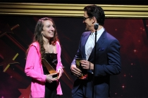 Matt Bomer presents an award to Melissa Hoppe at the 36th College Television Awards at the Skirball Cultural Center in Los Angeles, California, April 23, 2015.