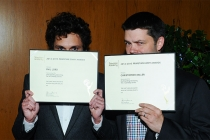 Phil Lord and Christopher Miller show off their certificates at the Directors nominee reception September 16, 2015, at the Directors Guild of America in Los Angeles, California.
