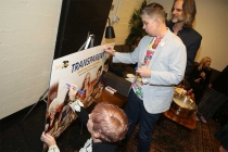 Production designer Cat Smith, writer Ali Liebegott, and cinematographer Jim Frohna sign a poster at Transparent: Anatomy of an Episode, March 17, 2016 in Los Angeles.