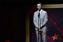 Reid Scott presents an award at the 36th College Television Awards at the Skirball Cultural Center in Los Angeles, California, April 23, 2015.
