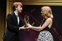 Rose McIver presents an award to Zach Ehrlich at the 36th College Television Awards at the Skirball Cultural Center in Los Angeles, California, April 23, 2015.