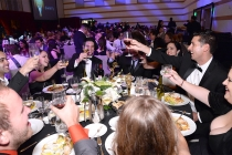 Guests toast at the 67th Los Angeles Area Emmy Awards July 25, 2015, at the Skirball Cultural Center in Los Angeles, California.