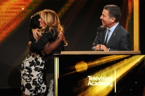 Uzo Aduba and Cat Deeley congratulate each other as Television Academy CEO Bruce Rosenblum announces that both women have been nominated for Emmys, Aduba for Supporting Actress in Orange is the New Black, and Deeley as host of So You Think You Can Dance,