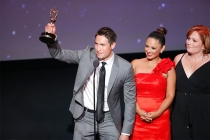 Whit Johnson, Daniella Guzman, and Mary Harris accept an award at the L.A. Area Emmy Awards presented at the Television Academy's Wolf Theatre at the Saban Media Center on Saturday, July 22, 2017, in North Hollywood, California.