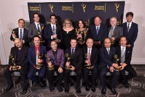 Host Kirsten Vangsness poses with the winners at the 68th Engineering Emmy Awards, October 28, 2016 at Loews Hollywood Hotel in Los Angeles, California.